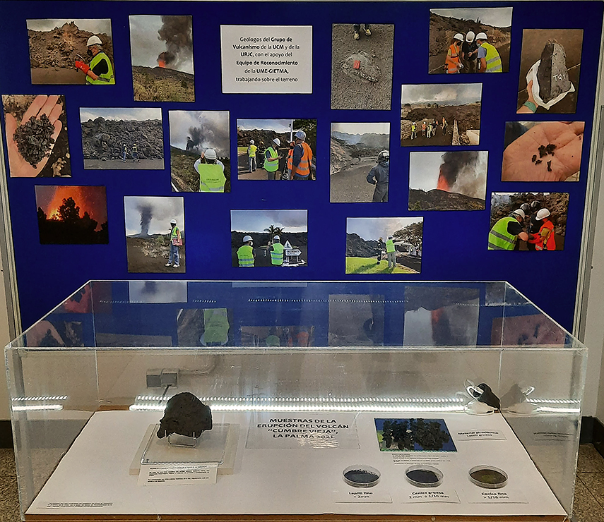Exposición en el pasillo principal de Geológicas, con imágenes y material procedentes del volcán de La Palma