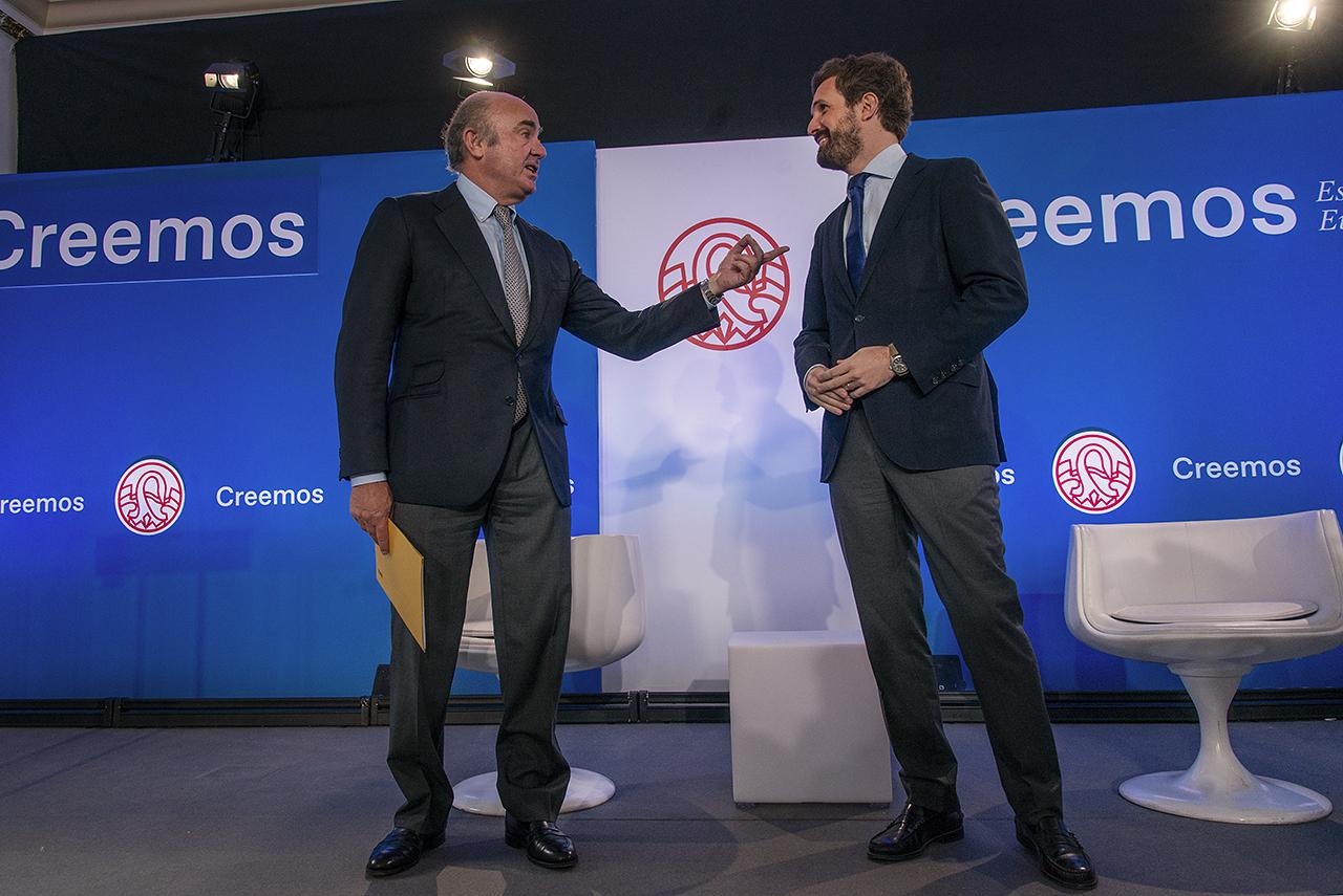 Luis de Guindos y Pablo Casado